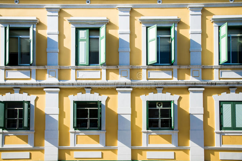 The windows of the yellow building stock images