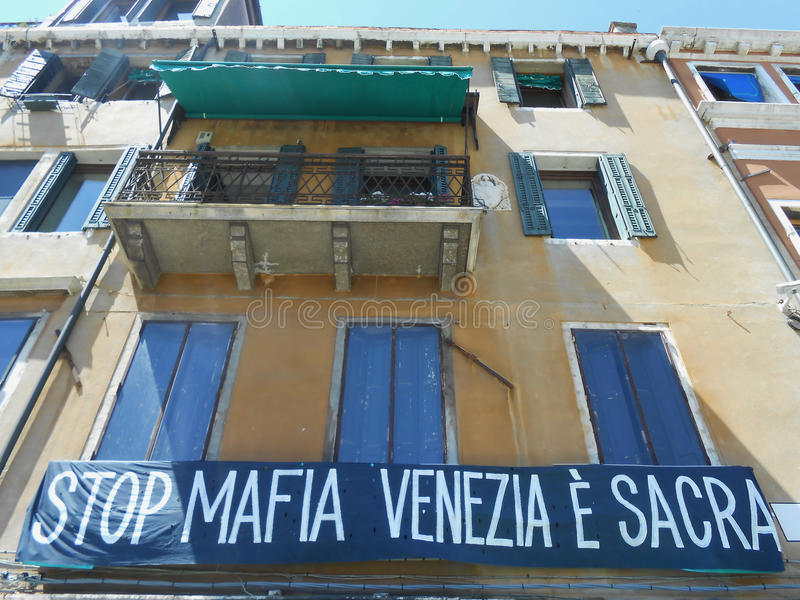 WINDOWS ON A YELLOW FACADE, VENICE, ITALY stock images