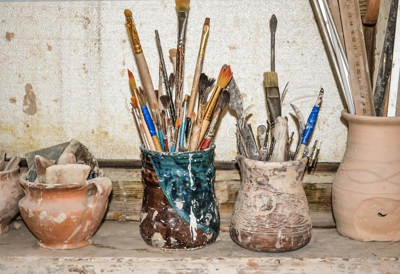 Windowsill stand in vases tools, tools for sculpting clay royalty free stock photography