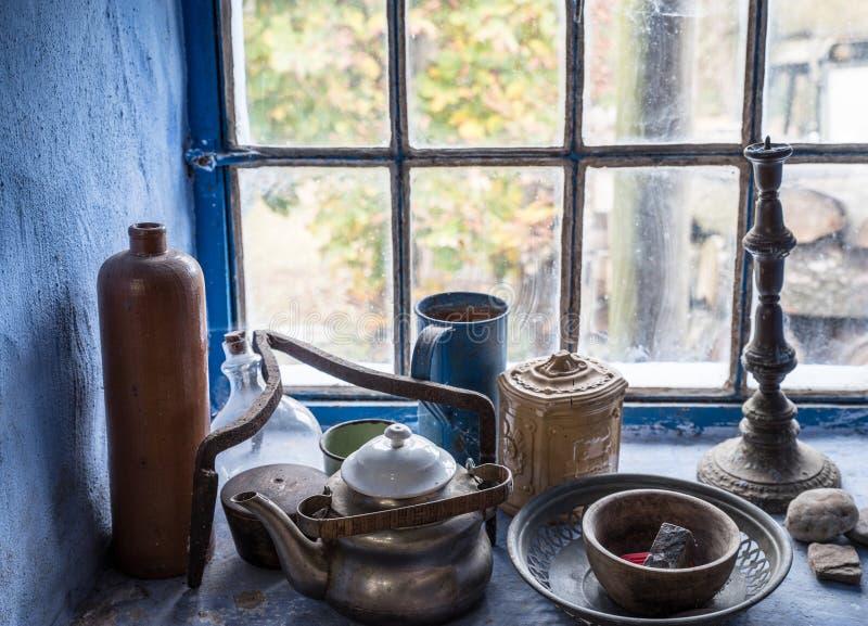 Windowsill still life with vintage objects stock photos