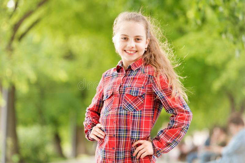 Windproof hairstyles. Girl little cute child enjoy walk on windy day nature background. Hairstyles to wear on windy days stock image