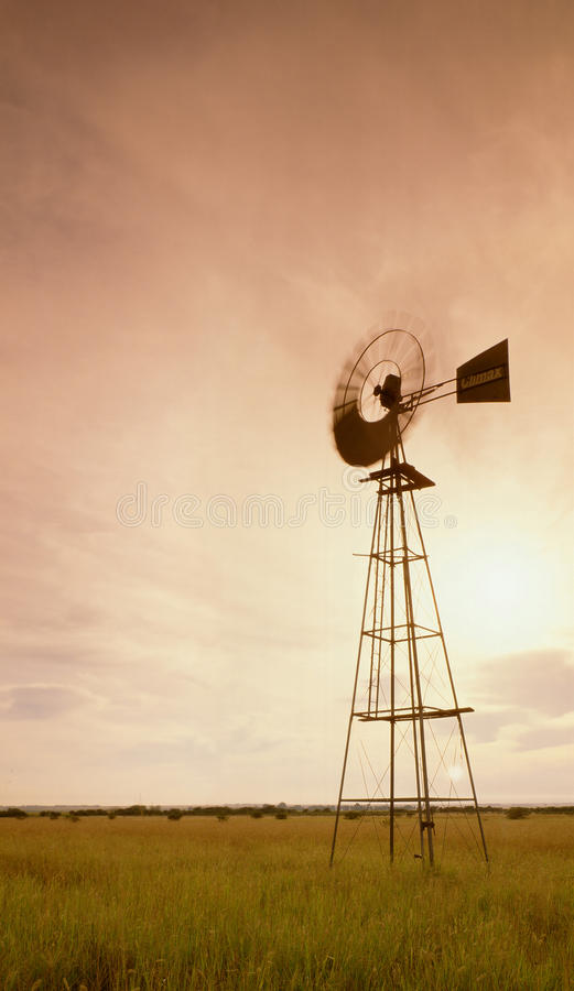 Windpump in field stock images
