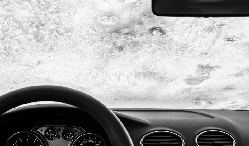 Windshield. The windshield of a car was covered by snow royalty free stock photography