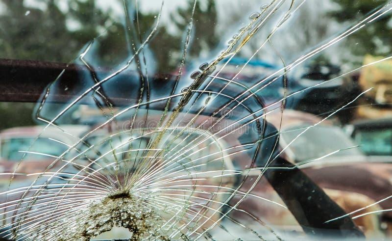Windshield on Abandoned Car in Junkyard stock photo