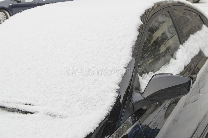 Windshield of the car swept by snow, winter background outdoors. Window, cold, frost, ice, season, weather, white, wiper, snowy, vehicle, closeup, automobile royalty free stock photography