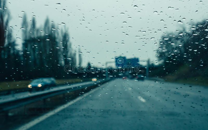 Windshield full with water drops on a heavy rain on highawy royalty free stock photography