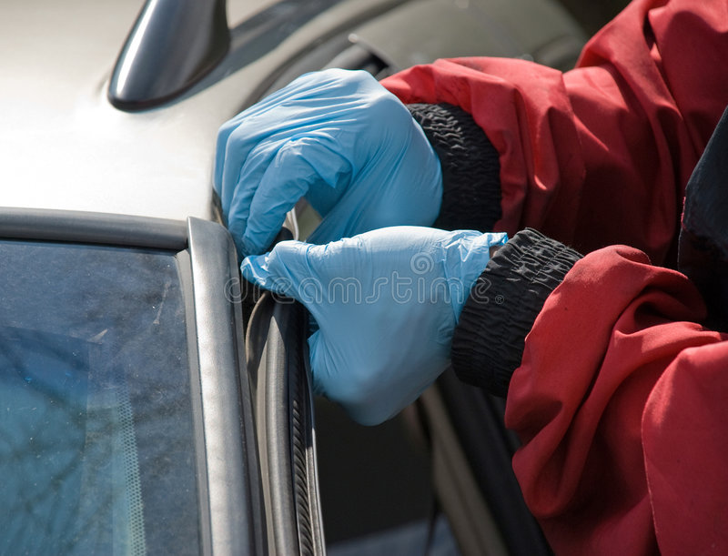 Windshield Repair. A worker removes plastic molding before replacing the windshield royalty free stock images