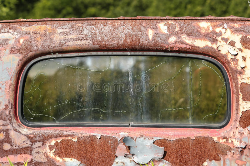 Windshield of rusted truck stock image