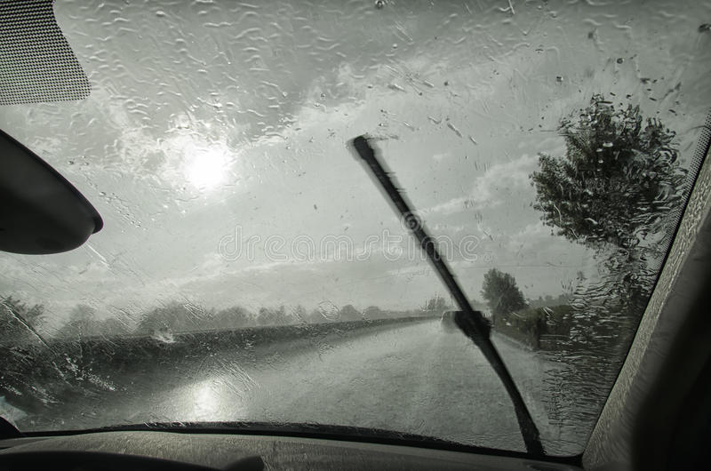Windshield wiper in action. With heavy rain royalty free stock photography
