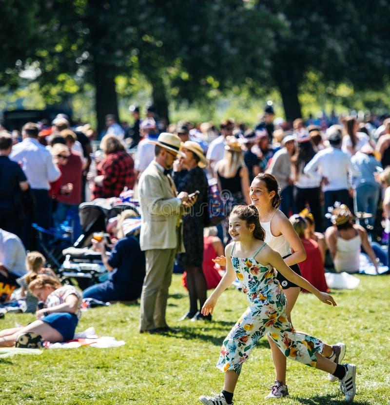 Royal Wedding atmosphere in Windsor girls having fun royalty free stock photo