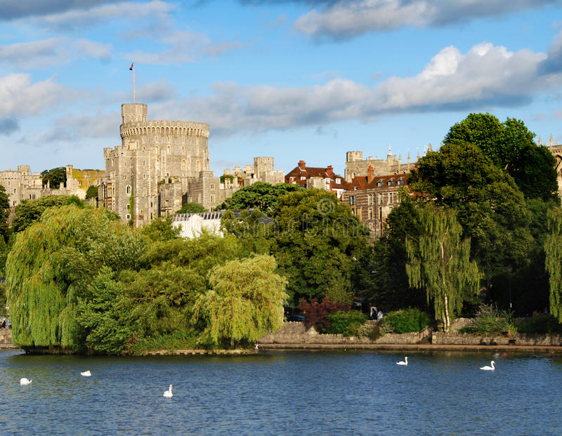 Windsor castle. Panorama of the mighty Windsor castle, the home of the Queen, with the river Thames in the foreground stock images