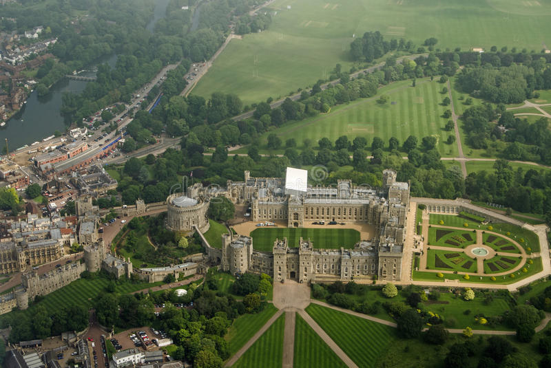 Windsor Castle, aerial view. View from a plane of the historic Windsor Castle, home of Queen Elizabeth II in Royal Berkshire. The River Thames passes to the left stock images