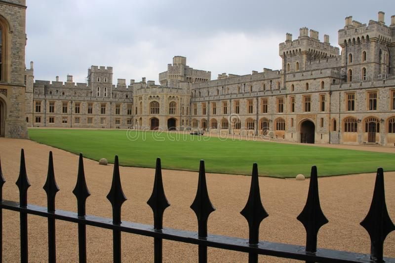 Windsor Castle and the black fence in England in the summer. stock images