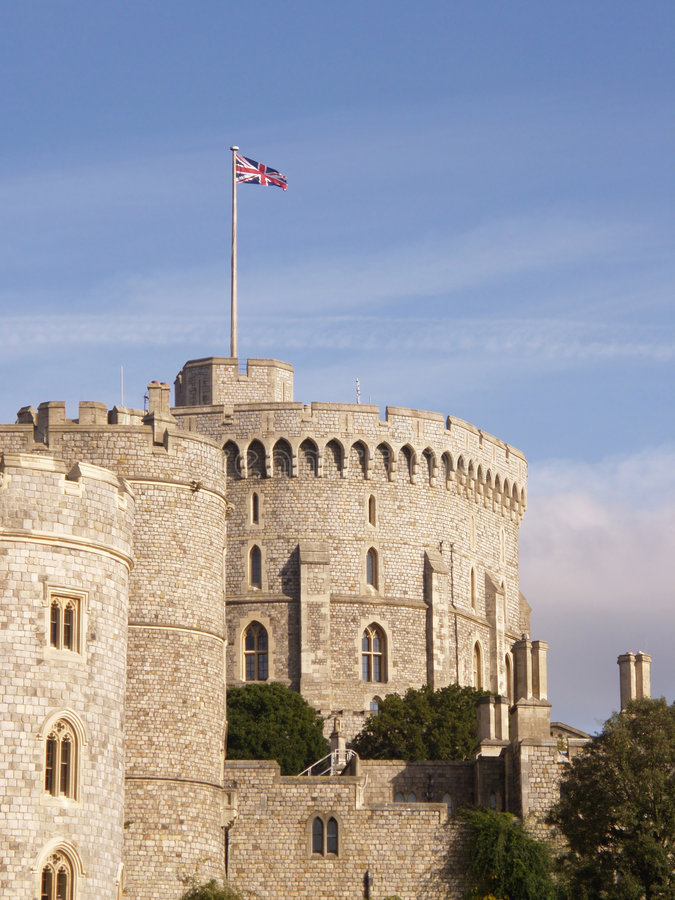 Windsor Castle Round Tower. The Union Jack flies over the round tower at Windsor Castle when the Queen is in residence royalty free stock photo
