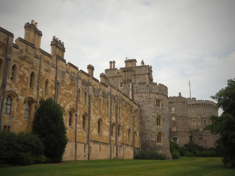 Windsor Castle is a royal residence at Windsor in the English county of Berkshire. It is notable for its long association. With the English and later British royalty free stock image