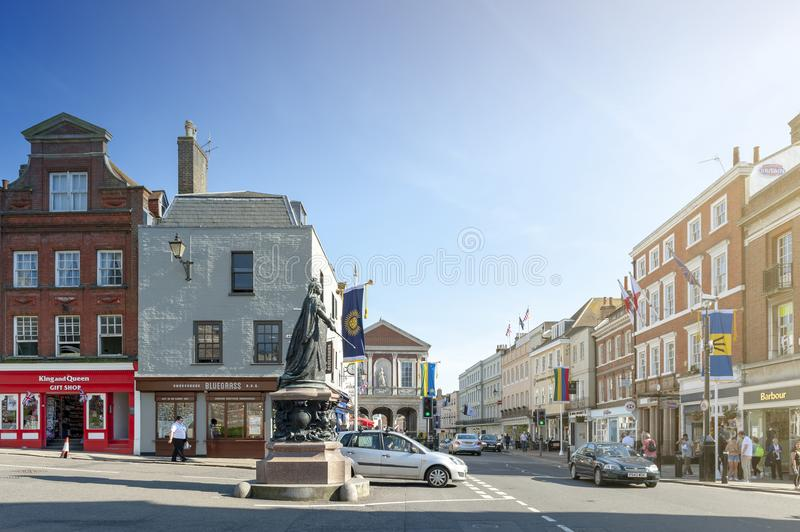 Queen Victoria Statue on Castle Hill Street and High Street next to Windsor Castle in the town of Windsor, Berkshire, England. Windsor, UK - April 2018: Queen stock photography