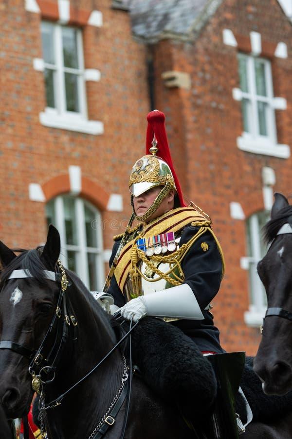 Windsor, UK - Maj 18 2019: Gospodarstwo domowe Koszaruje kawaleria zaznacza ich odjazd od Comberme fotografia royalty free