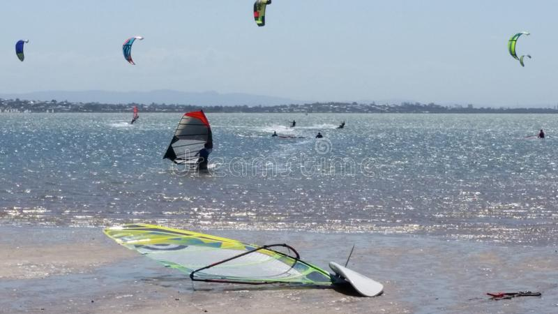 Windsurf board and sail on the beach royalty free stock image