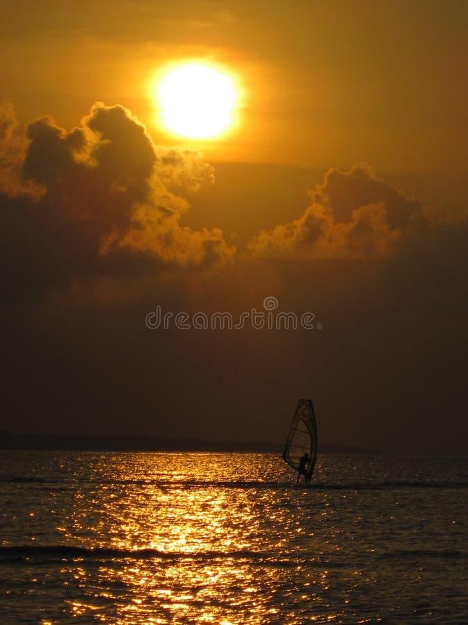 Windsurf at sunset stock images