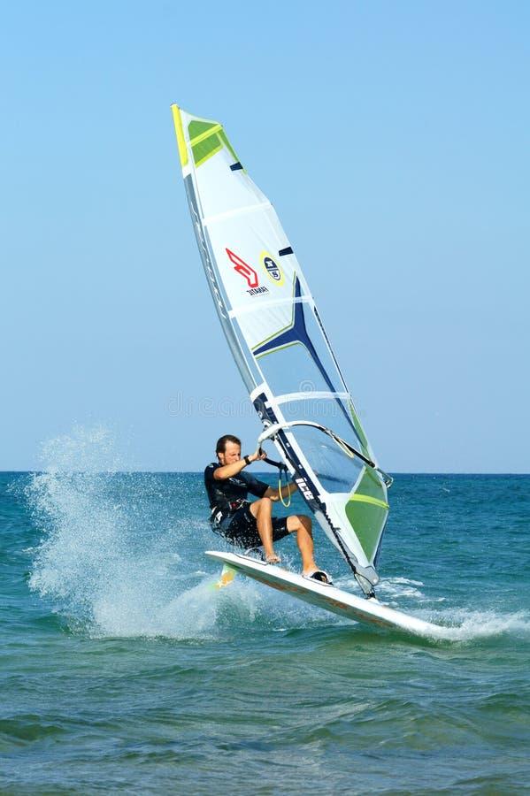 Windsurfer. Windsurfing freestyle at flat water royalty free stock photography