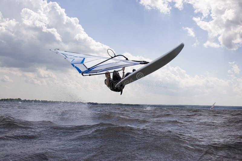 Windsurfer doing a nose landing royalty free stock photography