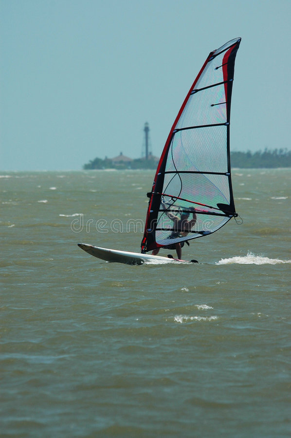 Download Windsurfer And Lighthouse Royalty Free Stock Image - Image: 189586