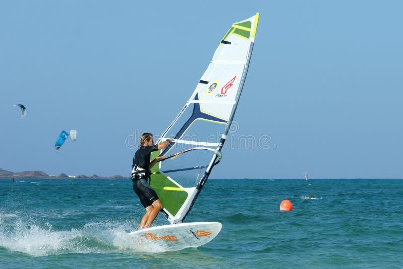 Windsurfer making duck jibe. Windsurfing on flat water. power jibe element stock photo