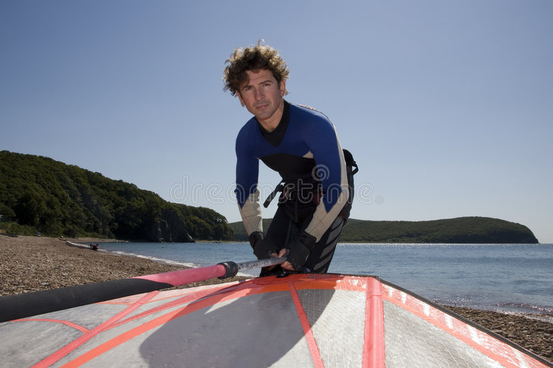 Windsurfer prepared for surf-riding stock photography