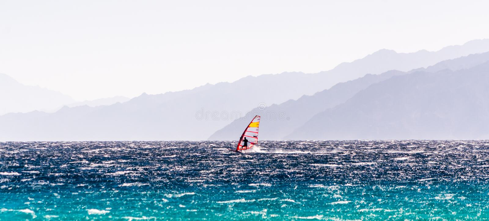 One surfer rides on a background of high mountains in Egypt Dahab South Sinai stock photo