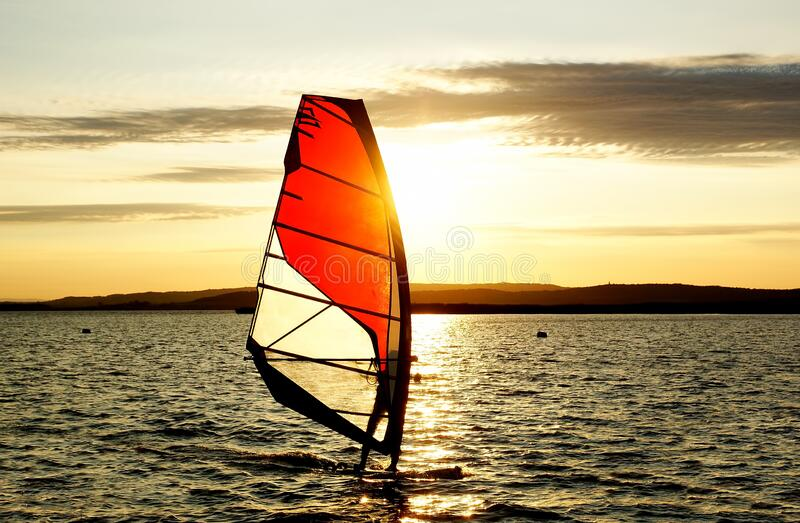Windsurfer silhouette against a sunset background royalty free stock photos