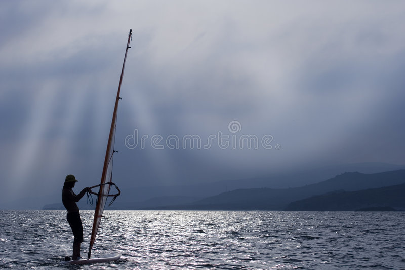 Download WINDSURFER and sunset stock photo. Image of light, male - 7123840