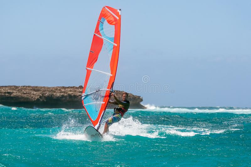 Windsurfer. Playing in the waves, acrobatic, action, active, adrenaline, adventure, aquatic, athletic, bay, board, danger, dynamic, extreme, float, foam, focus stock photography