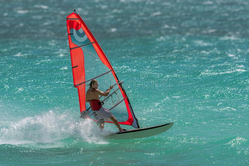 Windsurfer. Playing in the waves, acrobatic, action, active, adrenaline, adventure, aquatic, athletic, bay, board, danger, dynamic, extreme, float, foam, focus stock images
