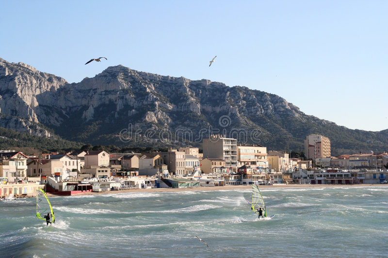 Windsurfers. Enjoying a very windy day in marseille, france stock image