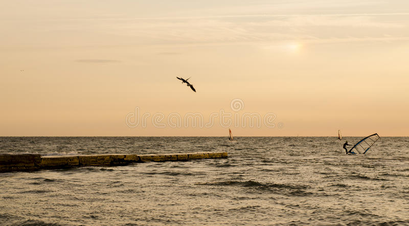 Windsurfers during the dawn. Photo is taken on 29 September stock images