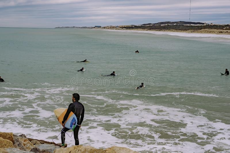 Windsurfers at the end of the breakwater.  royalty free stock photos