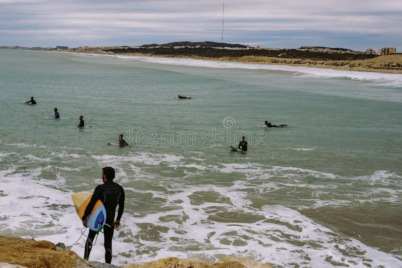 Windsurfers at the end of the breakwater.  stock photo