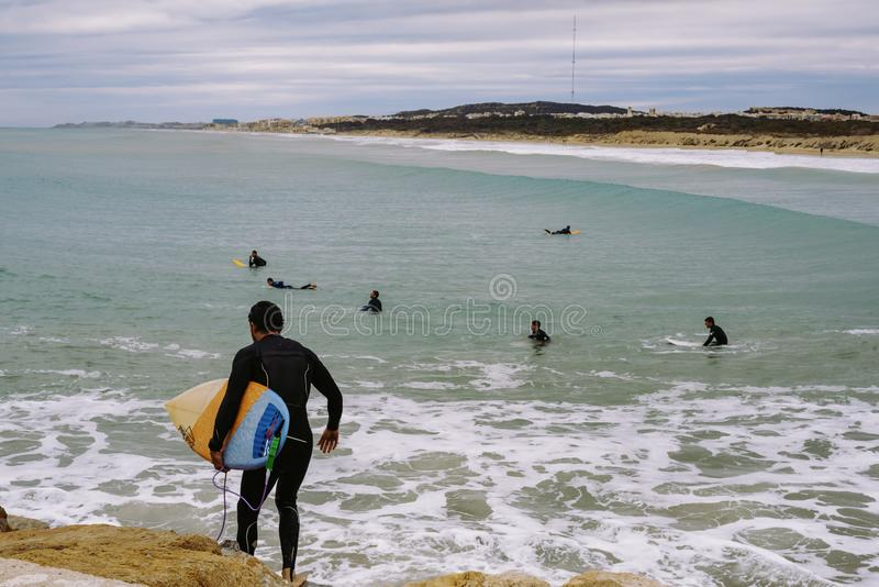 Windsurfers at the end of the breakwater.  stock photography
