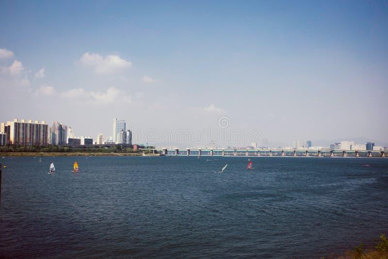 Windsurfers in Han river in Seoul, Korea. Windsurfers on a windy day in Han river in Seoul, Korea stock photography
