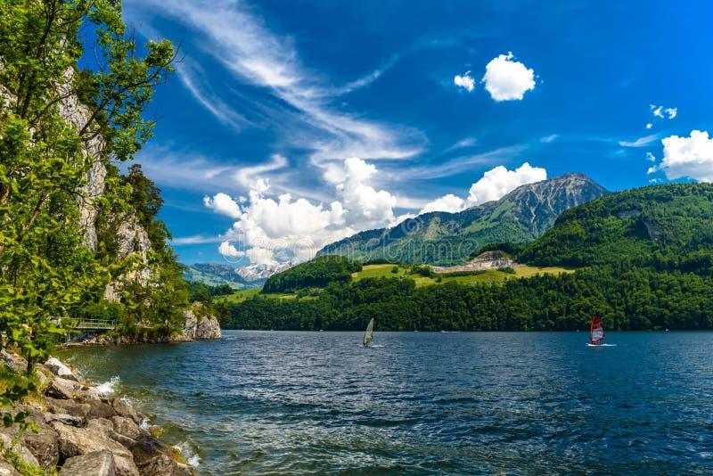 Windsurfers in the lake, Alpnachstadt, Alpnach, Obwalden, Switze. Windsurfers in the lake, Alpnachstadt, Alpnach Obwalden Switzerland royalty free stock image
