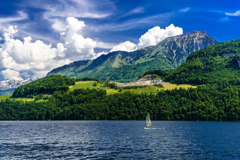 Windsurfers in the lake, Alpnachstadt, Alpnach, Obwalden, Switzerland. Windsurfers in the lake, Alpnachstadt, Alpnach Obwalden Switzerland stock photography