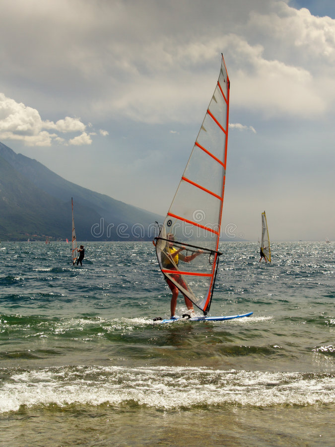 Windsurfers on lake Garda. In Italy on a cloudy day stock image