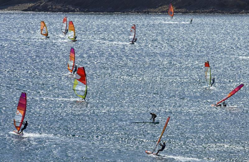 Windsurfers rides on the brilliant waves of the beautiful Mediterranean sea. On Cape Prasonisi Rhodes, Greece stock photo