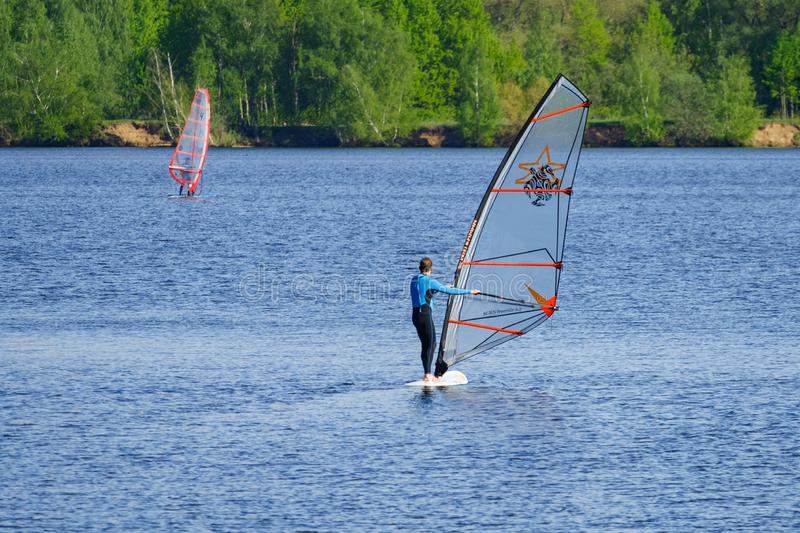 Windsurfers in the river. Moscow, Russia, may 2018: Windsurfers in the river editorial stock image