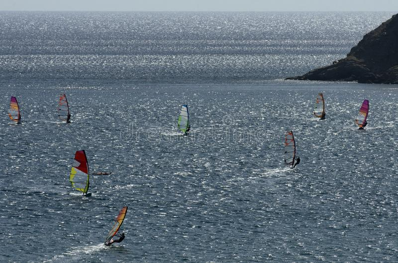 Windsurfers on the sparkling waves of the Mediterranean sea. At Cape Prasonisi Greece royalty free stock image