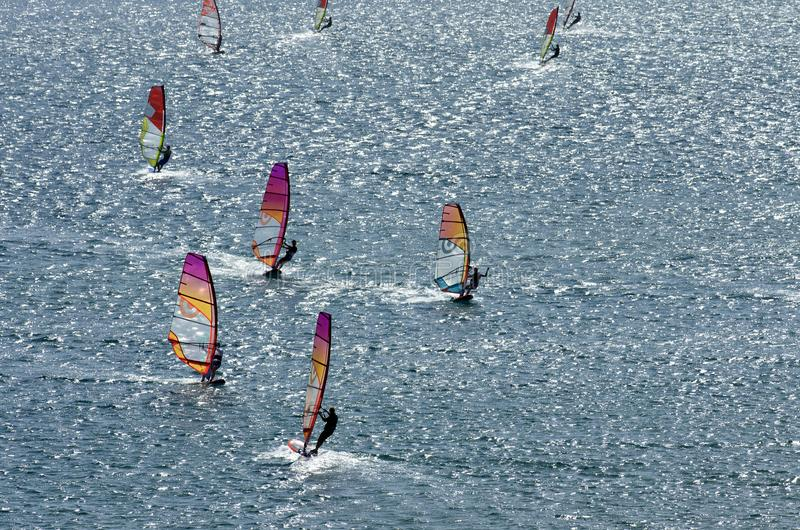 Windsurfers on the sparkling waves of the Mediterranean sea. At Cape Prasonisi Greece stock image