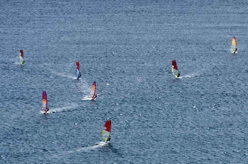 Windsurfers on the sparkling waves of the Mediterranean sea. At Cape Prasonisi Greece stock photos