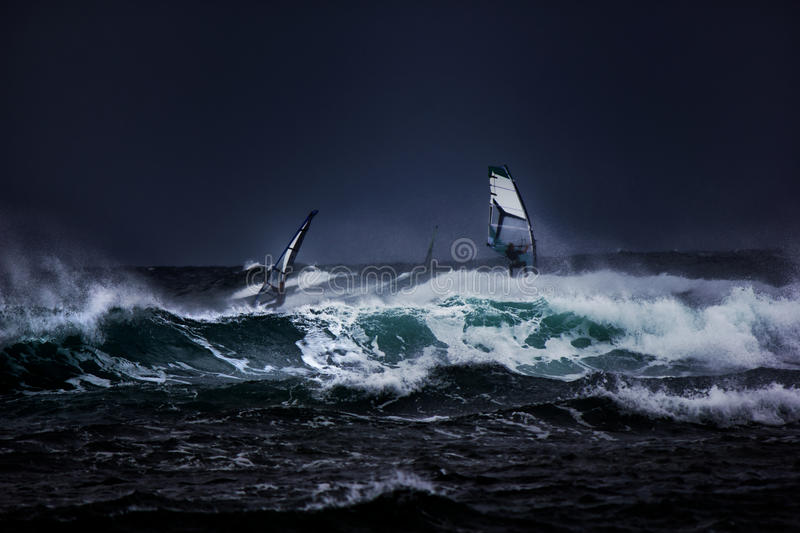 Windsurfers. In a storm, Long Reef royalty free stock photos
