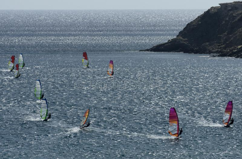 Windsurfers on the waves of the Mediterranean sea. At Cape Prasonisi, Rhodes Greece stock images