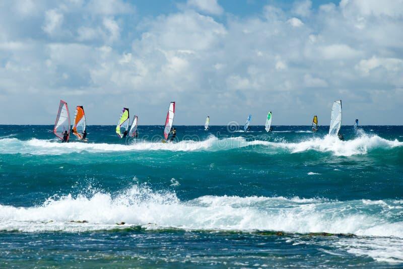 Windsurfers in windy weather on Maui Island. View of the windsurfers in windy weather on Maui Island stock photos